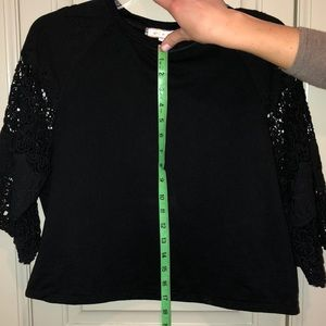 Anthropologie Cotton top with lace sleeves